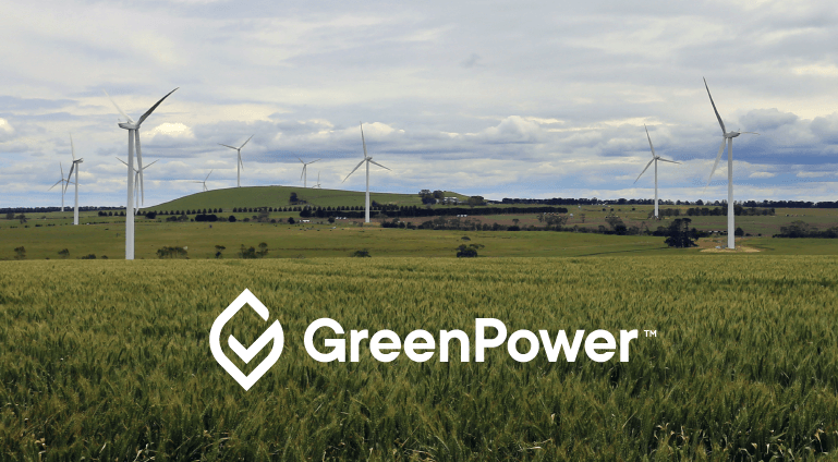 Photo of wind turbines in a green field with the GreenPower logo