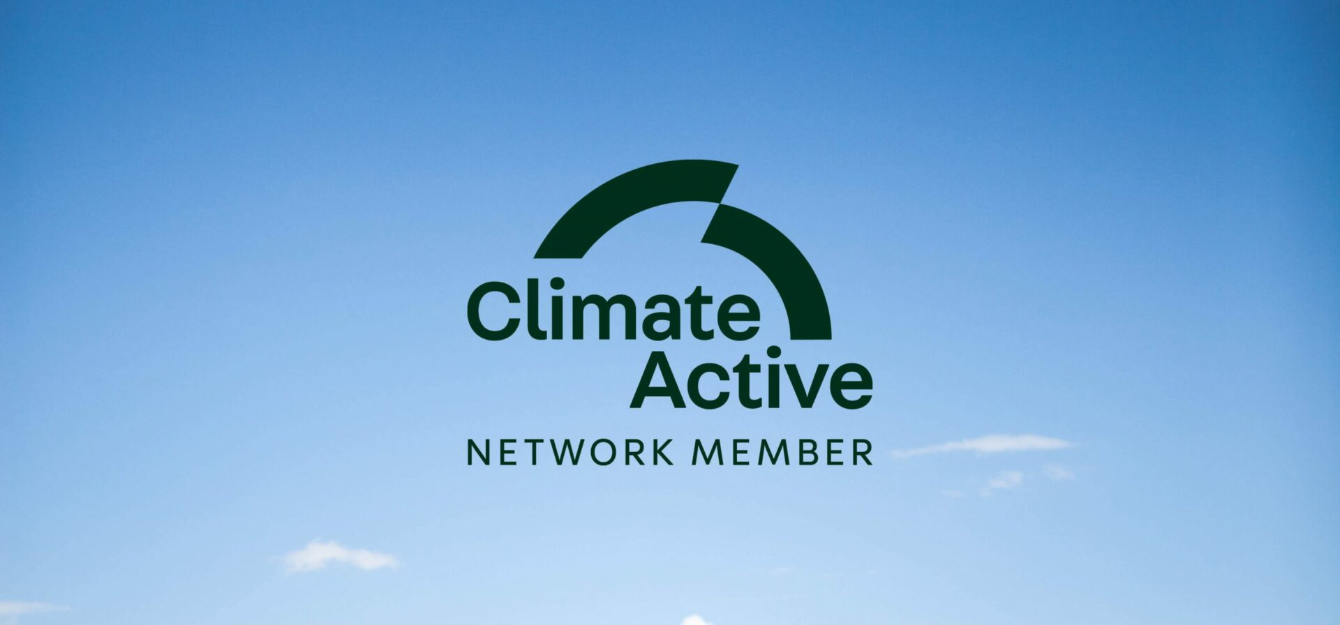 Image of blue sky with the climate active network member logo